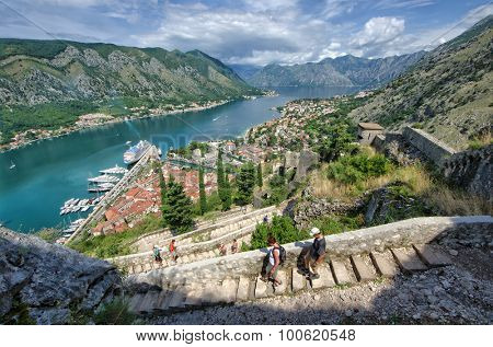 KOTOR, MONTENEGRO - JULY 14: tourists down the stairs from the St. John fortification lead to the bay of Kotor, often named as the southernmost fjord in Europe. Shot in 2014