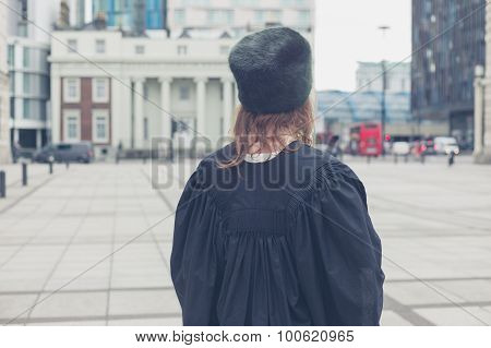 Woman In Hat And Graduation Gown