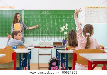 Teacher and students in the classroom: teaching