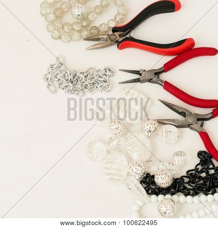 Various Beads And Tools For Making Jewelry