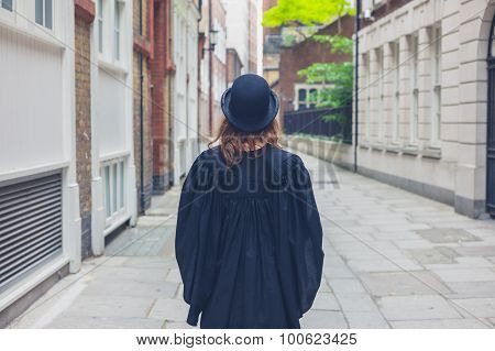 Woman In Bowler Hat And Graduation Gown