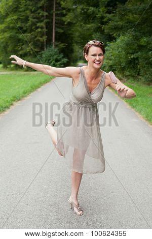 Playful Woman In Gown Enjoying Ice Cream Bar