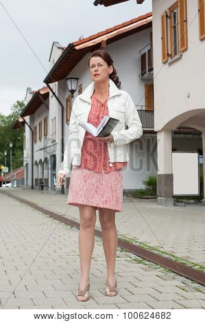 Casual Business Woman Walking With Open Notebook