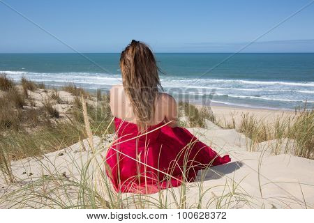 Female With A Red Dress Admiring A Marine View