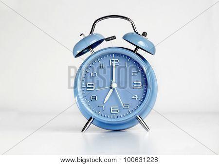 Blue analog retro twin bell alarm clock