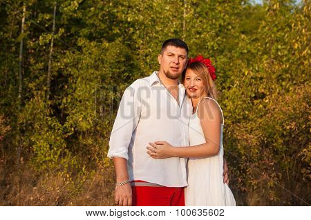 Husband And Wife Hugging In The Park Outdoors