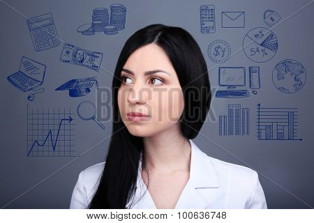 Young business woman thinking of her plans