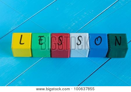Word Lesson on children's colourful cubes or blocks - educational background for teaching.