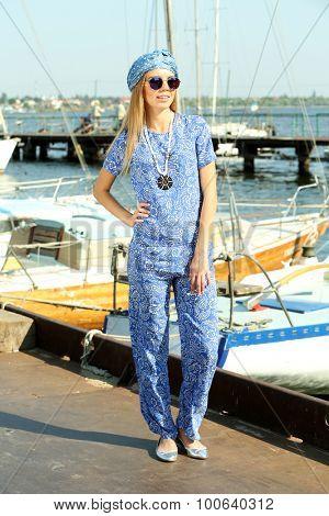 Beautiful young girl posing on pier