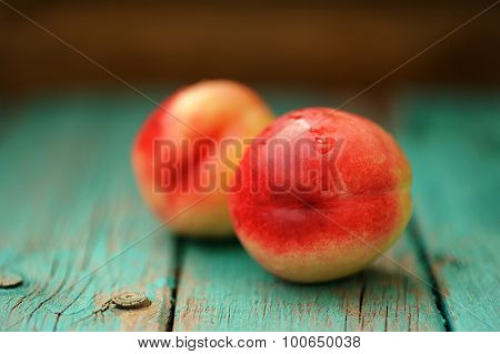 Two Fresh Ripe Whole Nectarines With Water Drops On Vintage Turquoise Table Selective Focus