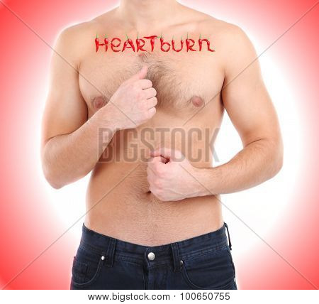 Word Heartburn made with red hot peppers on man's body, Heartburn concept