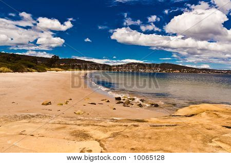 Beach Scene With Some Clouds In A Blue Sky