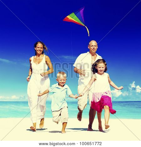 Family running on the beach Happiness Concept
