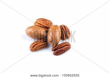 Few Pecan Nuts Isolated On White