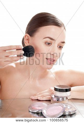 Beautiful Girl Applying  Blusher By Brush On Her Face - Isolated On White Background.
