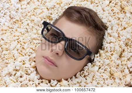 Serious Young Boy In Stereo Glasses Looking Out Of Popcorn