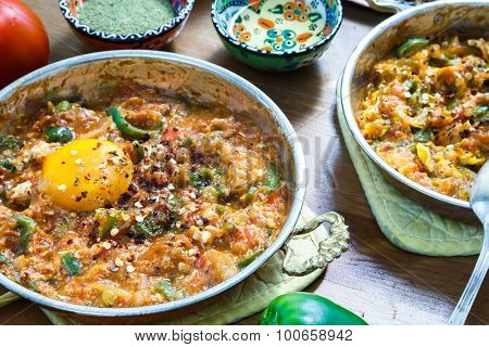 Turkish food Menemen in copper pan