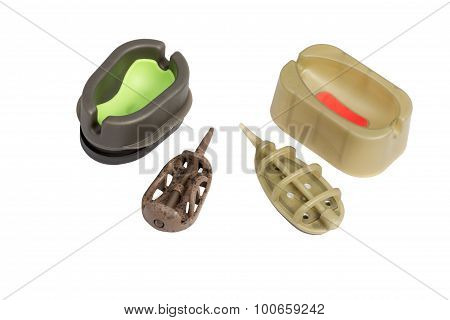 Two Fishing Feeder And Moulds Isolated On A White Background