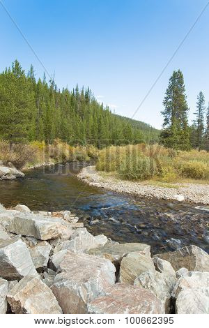 River Flowing Through Mountain Landscape.