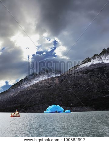 Yacht for tourists on Lake Grey. Sunny and windy summer day in the national park Torres del Paine. Patagonia, Chile