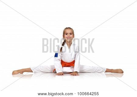 Karate Girl Sitting On Splits