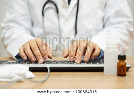 Doctor Is Typing Diagnose On Computer Keyboard