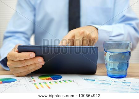 Business. Hands Of Businessman  Working With Tablet Computer And Financial Papers