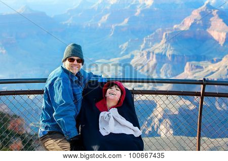 Father With Disabled Son In Wheelchair At Grand Canyon, Arizona