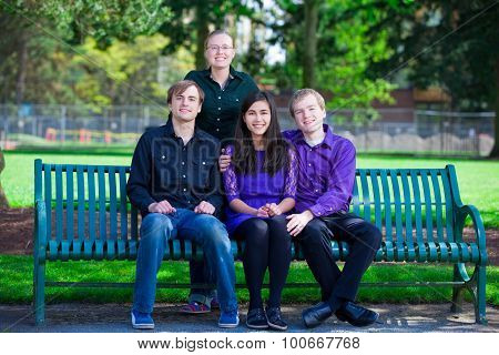 Four Young Multiethnic Friends Together At Park