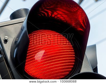 a traffic light shows red light on the road.
