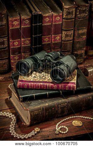 Binoculars And Old Books