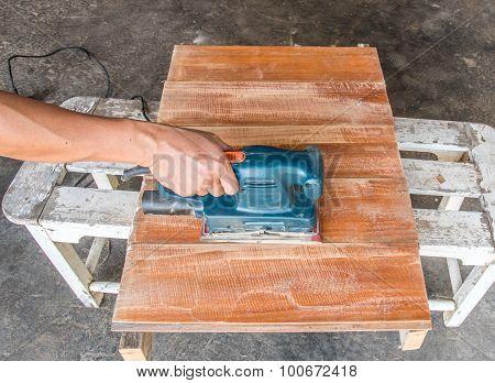 Carpenter Use Electric Sander Polish Wood Board