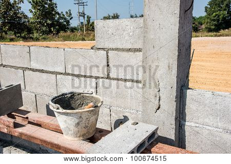 Worker Make Concrete Wall By Cement Block And Plaster At Construction Site ,worker Hand Wearing Glov