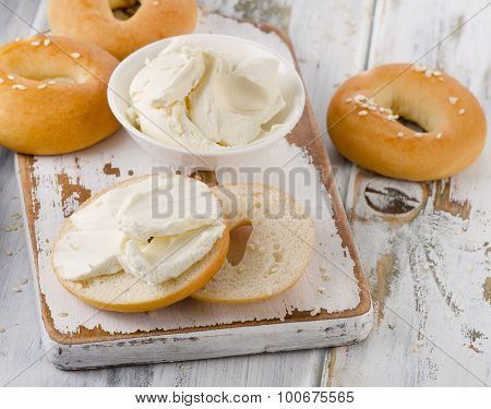 Bagels With Cream Cheese On  A Wooden Table.