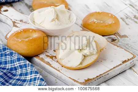 Bagels With Cream Cheese On A White Wooden Table.