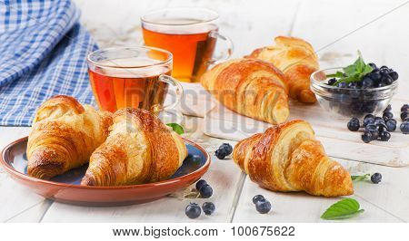 Croissants With Glass Cups Of Tea