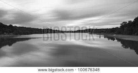 Llong Exposure Black And White Landscape Image Of Lake At Sunset