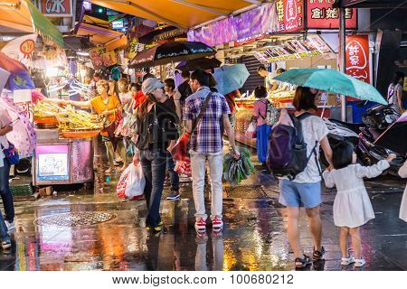 Shoppers Walking Around  Bali Left Bank Park Traditional Market In Taiwan