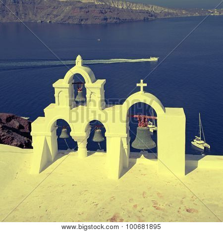 Bell Tower Of White Church Above Blue Sea, Santorini, Greece.
