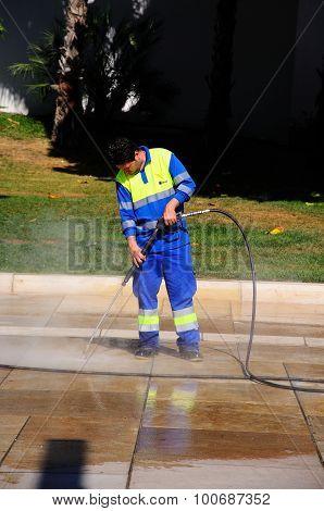 Man jet washing, Malaga.