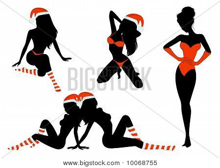 Silhouette of beautiful girls is in socks and cap of Santa Claus