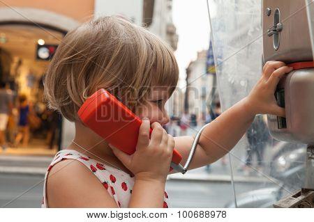 Little Blond Girl Talking On The Urban Street Phone