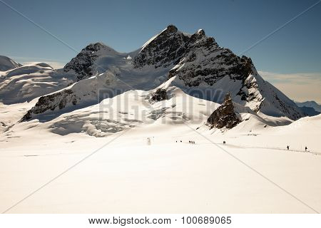 Sunny day mountain peaks snow and glaciers on Jungfraujoch Interlaken Switzerland