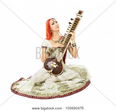 Beautiful Redhead Woman In Indian Sari With Oriental Jewelry Playing The Sitar