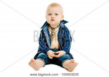 Little Dissatisfied Boy In A Plaid Shirt