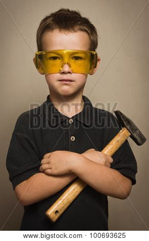 Boy In Goggles With A Hammer