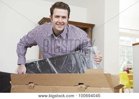 Man Unpacking New Television At Home