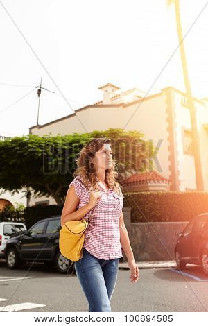 Confident Woman Walking Down The Street