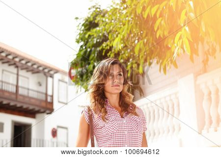 Young Woman Walking Outdoors During The Day