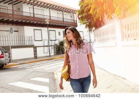 Confident Woman Walking Outdoors During The Day